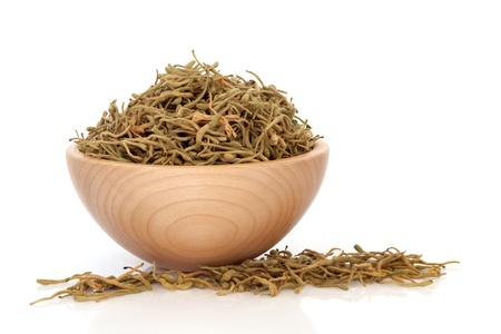 honeysuckle: Honeysuckle flower dried herb in a beech wood bowl used in traditional chinese herbal medicine isolated over white background.   Jin yin Hua. Flos lonicerae japonicae.