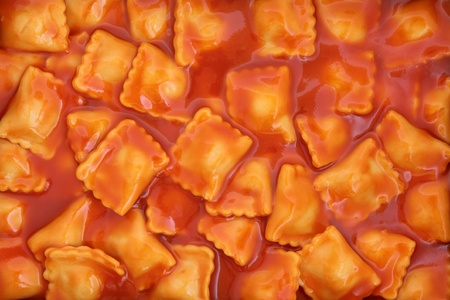 Ravioli pasta in a tomato sauce forming a background. Stock Photo - 11378017