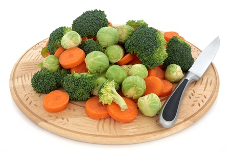 Sprouts, broccoli and carrot vegetables on a wooden chopping board with stainless steel knife isolated over white background. Stock Photo - 11378018