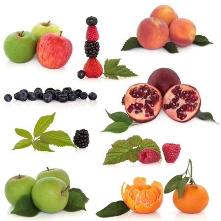 sampler:  Large collection of fruit with leaf sprigs isolated over white background. High in antioxidants.