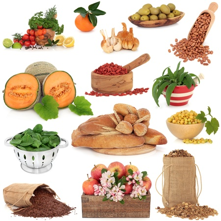 Healthy food collection high in antioxidants and vitamins isolated over white background. photo