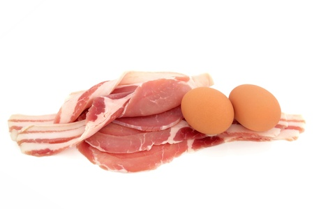 uncooked bacon: Eggs and rashers of bacon  uncooked isolated over white background.