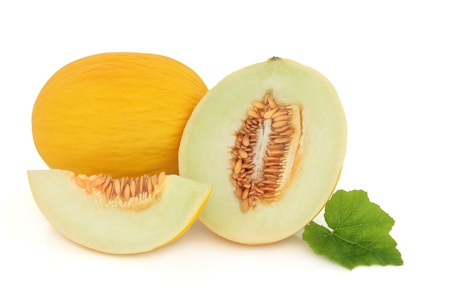 honeydew: Honeydew melon whole and sliced with leaf sprig isolated over white background.