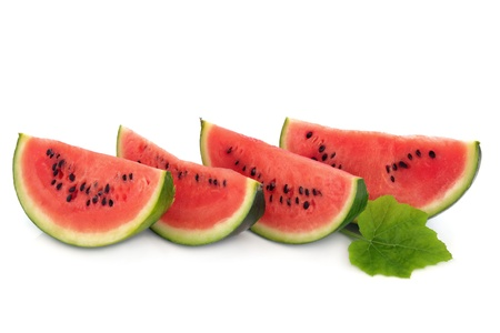 water melon: Watermelon fruit in slices with leaf sprig isolated over white background.