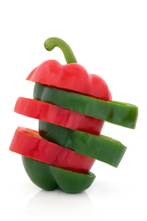 bell peppers: Red and green sliced pepper in layers isolated over white background.