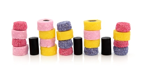 licorice: Liquorice allsort sweets in colorful abstract stack design isolated over white background. Editorial