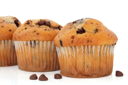 Chocolate chip and cranberry muffin cup cakes with loose chips over white background  Selective focus  photo