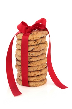 Chocolate chip cookie stack tied with a red satin ribbon isolated over white background  photo