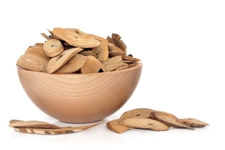 lonicerae: Honeysuckle stem herb used in chinese herbal medicine in a beech wood bowl on white background   Ren dong teng, Rambus lonicerae japonicae