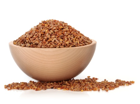 laxative: Bilta seed used in chinese herbal medicine in a beech wood bowl over white background  Used as a laxative and sedative