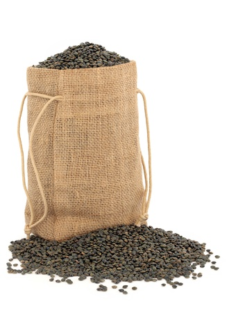 Puy lentils in a hessian sack over white background  photo