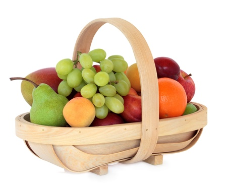 Apricot, mango, plum, nectarine, pear, grape, orange and apple fruit in a rustic wooden basket over white background  photo