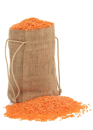lentil: Red lentils in a hessian sack on white background  Stock Photo