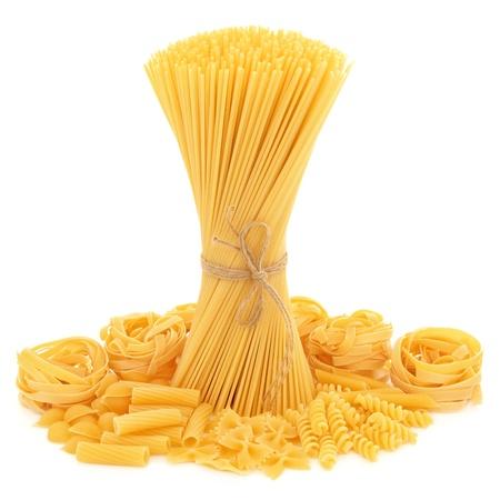 fusilli: Spaghetti tied in a bunch with string and tagliatelle, conchiglie, rigatoni, farfalle, fusilli and penne pasta  scattered over white background