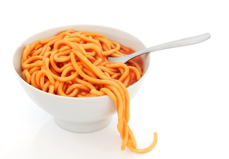 Spaghetti pasta in tomato sauce in a porcelain bowl with fork over white background Stock Photo - 13597102