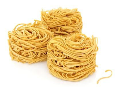 Egg noodle stacks on a white background  Stock Photo - 13693399