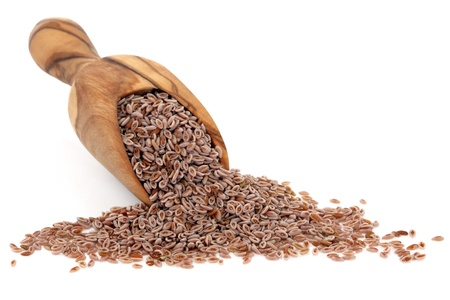 Pink psyllium seed in an olive wood scoop over white background
