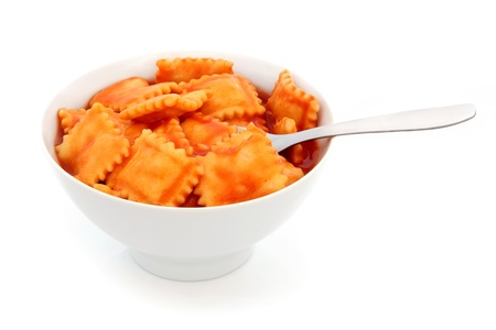 Ravioli pasta in a porcelain bowl with fork over white background Stock Photo - 13987012