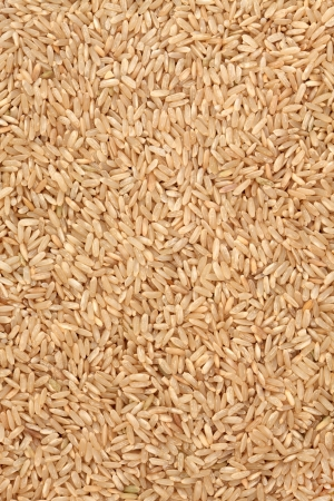 brown rice: Brown rice forming a  textured background  Stock Photo