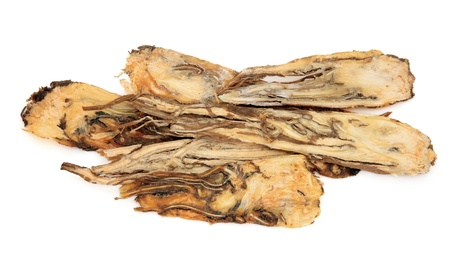 Angelica root used in traditional chinese herbal medicine  over white background    photo