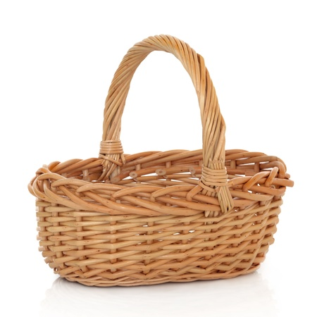 shopping baskets: Wicker shopping basket on a white background