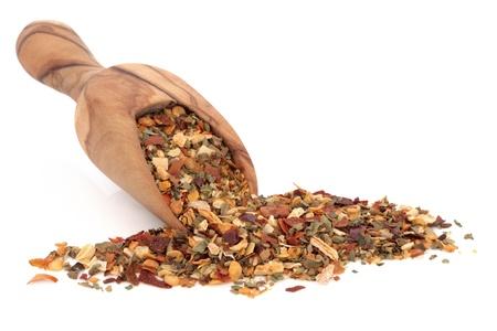 piri: Piri piri spice mixture for barbecue seasoning in an olive wood scoop over white background
