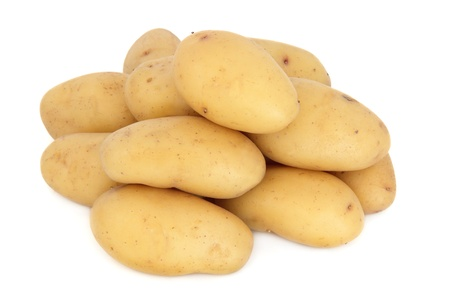 charlotte: New potato vegetables in a pile over white background, charlotte variety