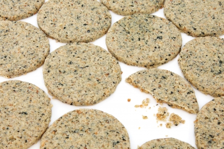 Laverbread oatcake savory biscuits and one in half with crumbs over white background  Welsh specialty Stock Photo - 15220551