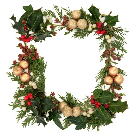 christmas ivy: Christmas decorative border of holly, mistletoe, ivy, cedar and gold baubles over white background