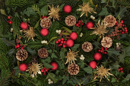 with mistletoe: Christmas background of holly, mistletoe and ivy leaf springs with blue spruce, pine cones and red bauble arrangement