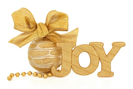 Christmas joy glitter sign, gold and silver bauble with bow and bead chain over white background Stock Photo - 15572757
