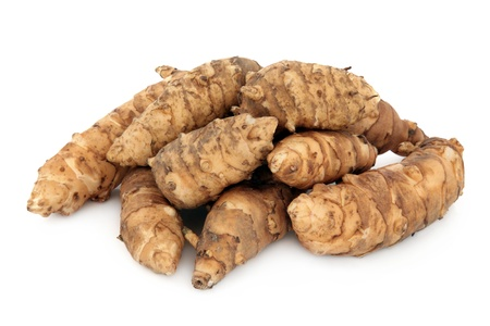 Jerusalem artichoke vegetables in a pile over white background  Stock Photo - 16100810