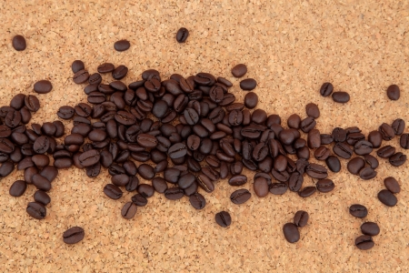 Coffee beans in abstract pattern on natural cork background Stock Photo - 16100836