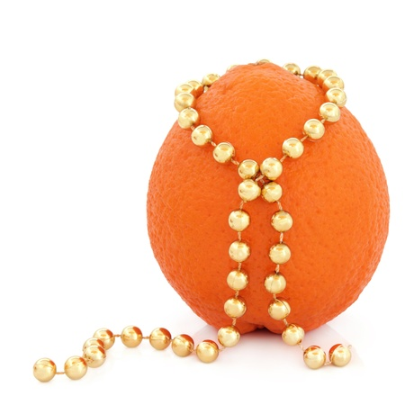 Orange fruit with gold bead strand over white background  Stock Photo - 16244190