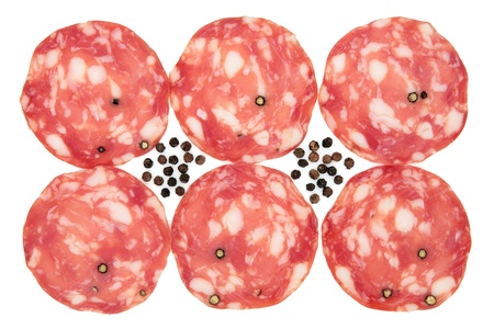 Pepper salami in slices with black peppercorns over white background  Stock Photo - 16383866