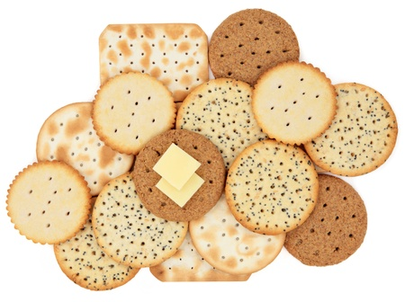 Cracker biscuit selection with cheese slices on one over white background  Stock Photo - 16383863