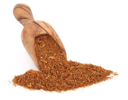 Barbecue spice mixture in an olive wood scoop over white background  Stock Photo - 16383852