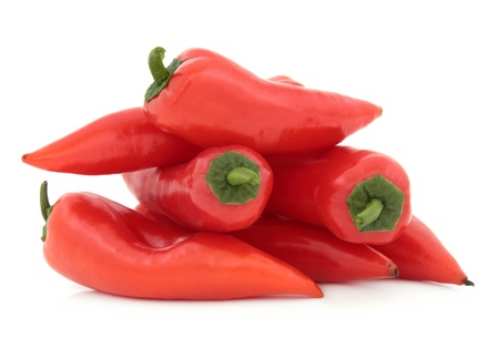 Red chili pepper vegetables in a pile over white background  Stock Photo - 16383850