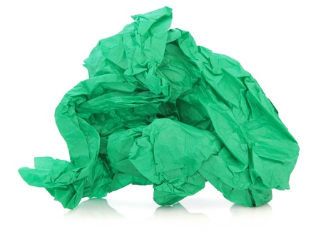 Green tissue paper in a crumpled up ball over white background Stock Photo - 17119654