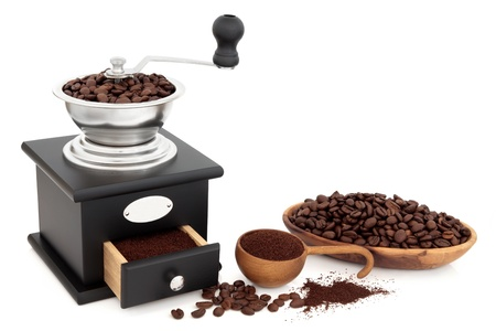 Retro coffee grinder, beans and in ground form over white background Stock Photo - 17119657