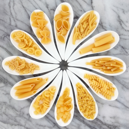 Pasta selection in white porcelain dishes over marble background  Stock Photo - 17119334