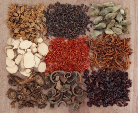 Traditional chinese herbal medicine selection over papyrus background  photo