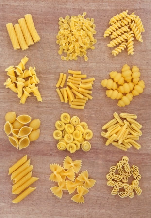 Pasta selection in piles over papyrus background Stock Photo - 17248870
