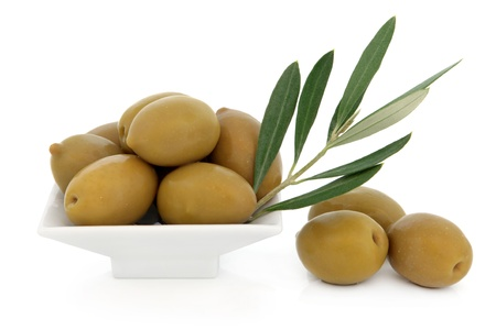 Green olives with leaf sprig over white background  Stock Photo - 17420756