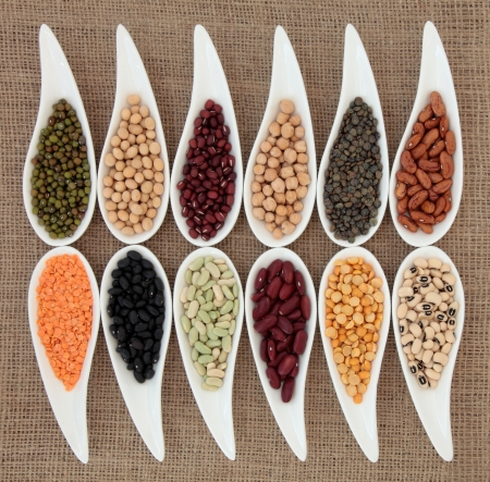 Pulses vegetable selection of peas, beans and lentils in white porcelain bowls over hessian background Stock Photo - 17699503