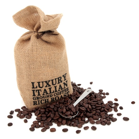 Luxury italian coffee beans and a hessian sack with scoop over white background  Stock Photo - 17699496