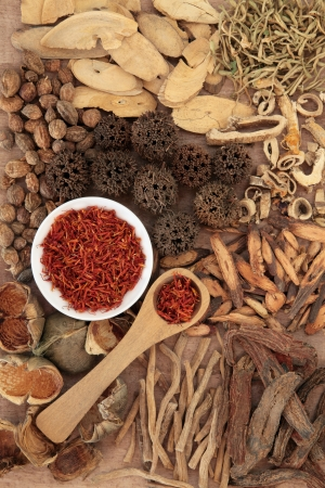 alternative medicine: Traditional chinese herbal medicine selection over papyrus background