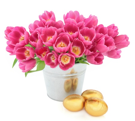 Tulip flower arrangement in a metal vase with easter egg group over white background  Stock Photo - 17699495