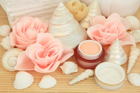 Bathroom accessories with rose spa soap petal buds and moisturising cream over bamboo background  Stock Photo - 17817731