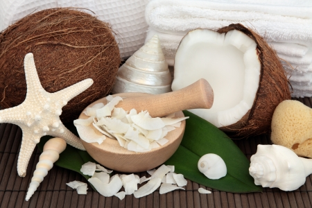 Coconut spa accessories with shells, towels and sponges over bamboo background  Stock Photo - 17817735